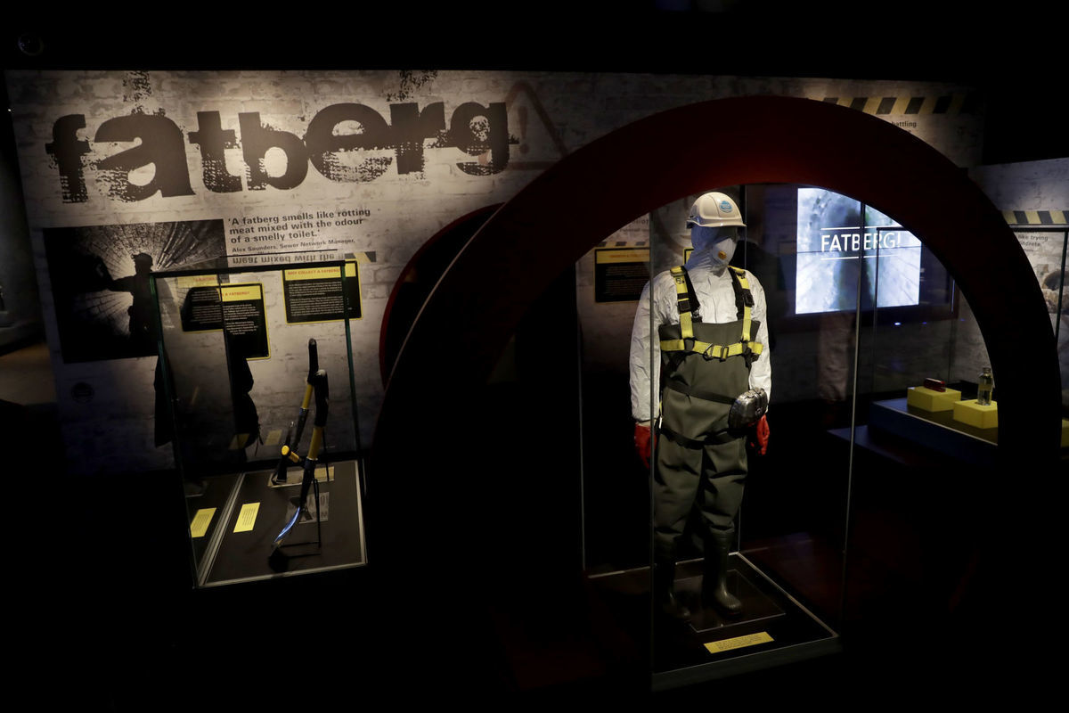 The exhibit showcases the kind of protective gear sewer workers had to wear while working to clear the fatberg. (Photo by Associated Press)