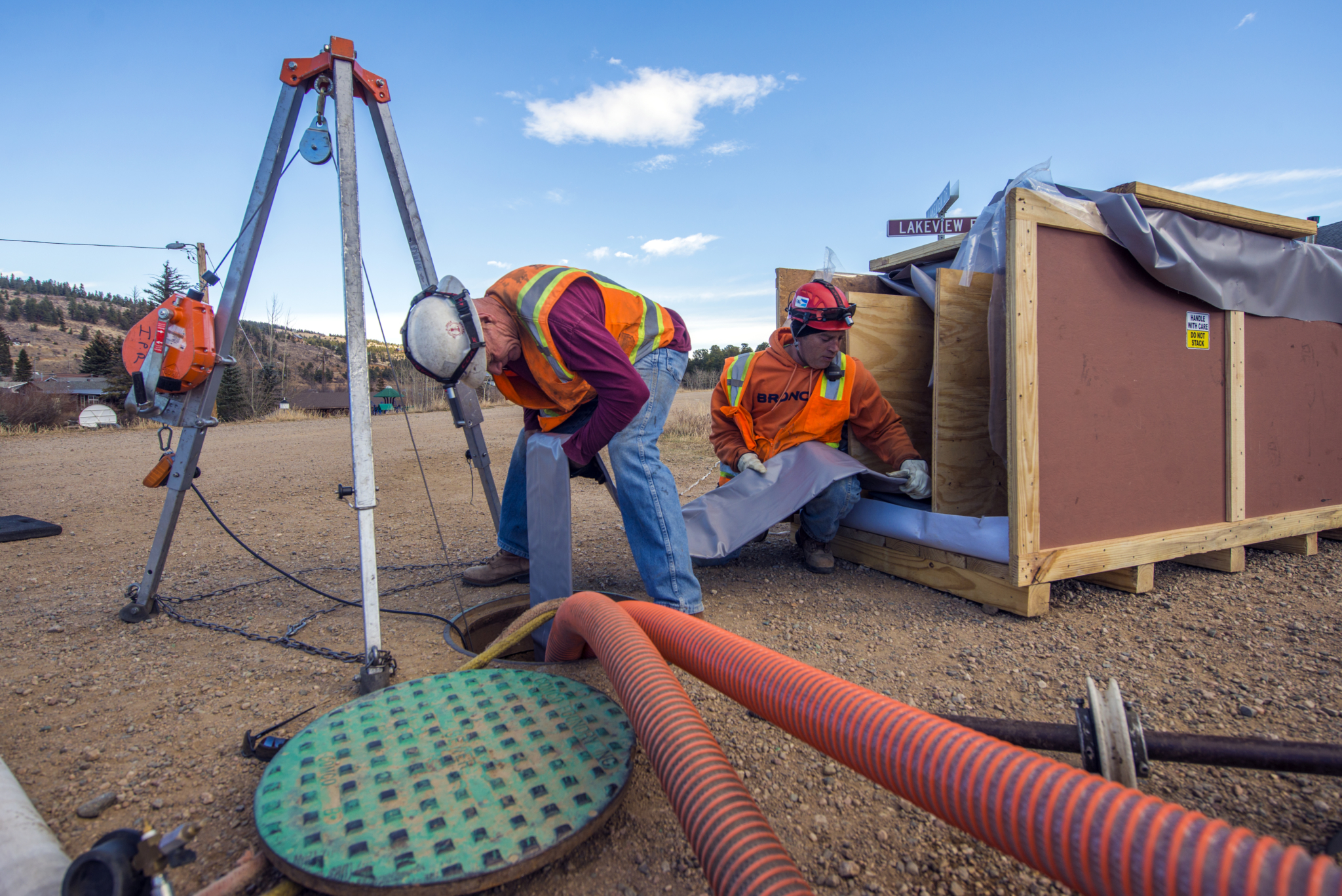 Allen Hamm and Tom Spiegel of C&L Water Solutions in Littleton, Colorado, featured in the February issue, insert a fiberglass reinforced liner into a sewer pipe.