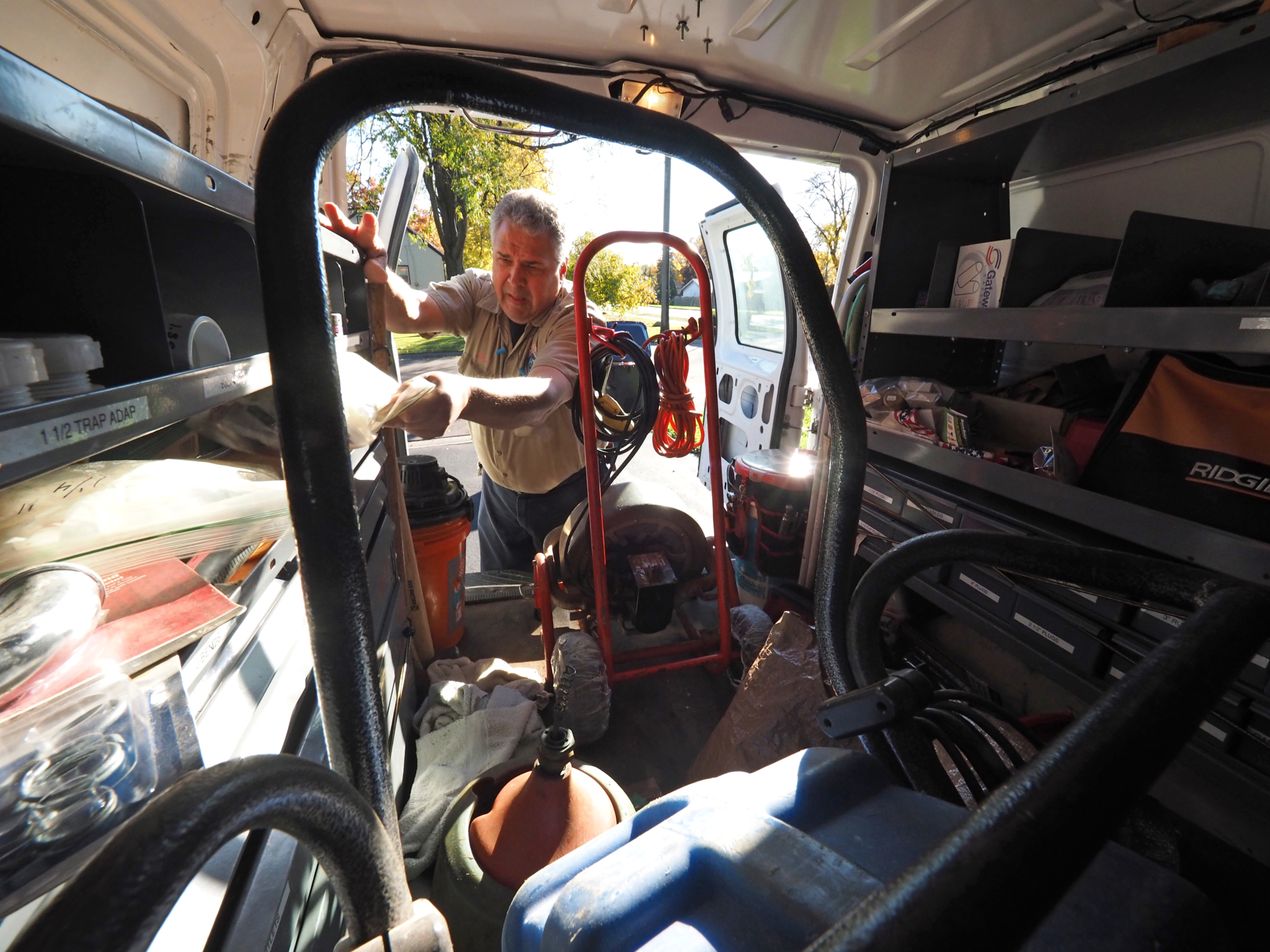 Steve Nerheim, owner of Steve's Professional Sewer & Drain Service, featured in the January issue, loads his 2007 Ford E250 van and checks supplies before heading out for the day from his home base in New Brighton, Minnesota.