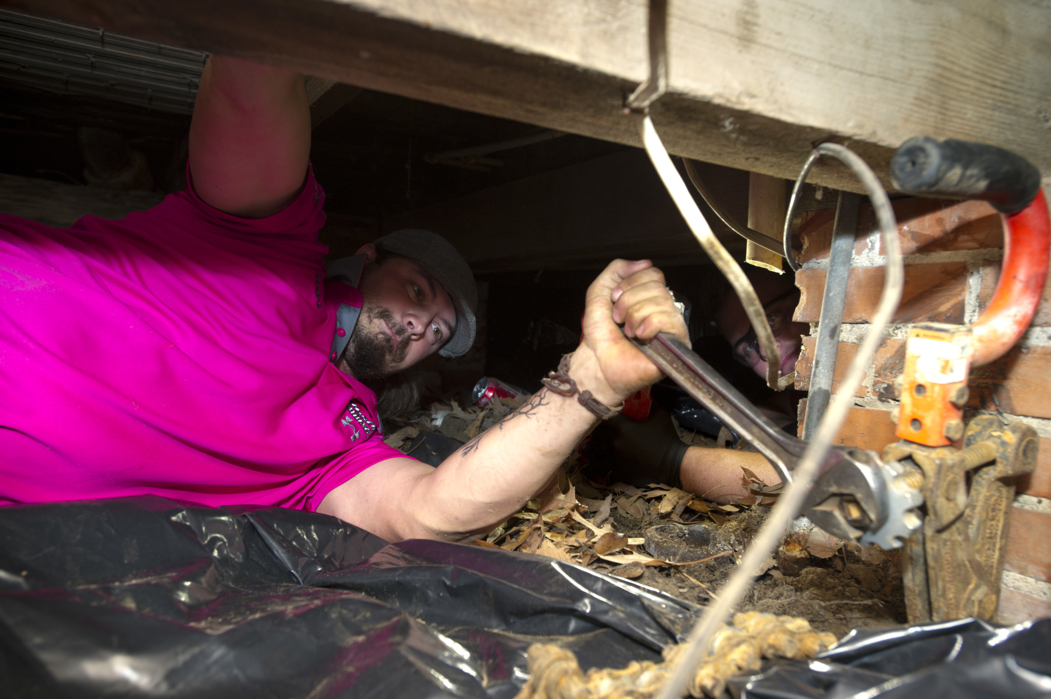 Jessie Wigley of Parsons Plumbing, Heating & Cooling in Ball, Louisiana, featured in the July issue, works under a house on a job.