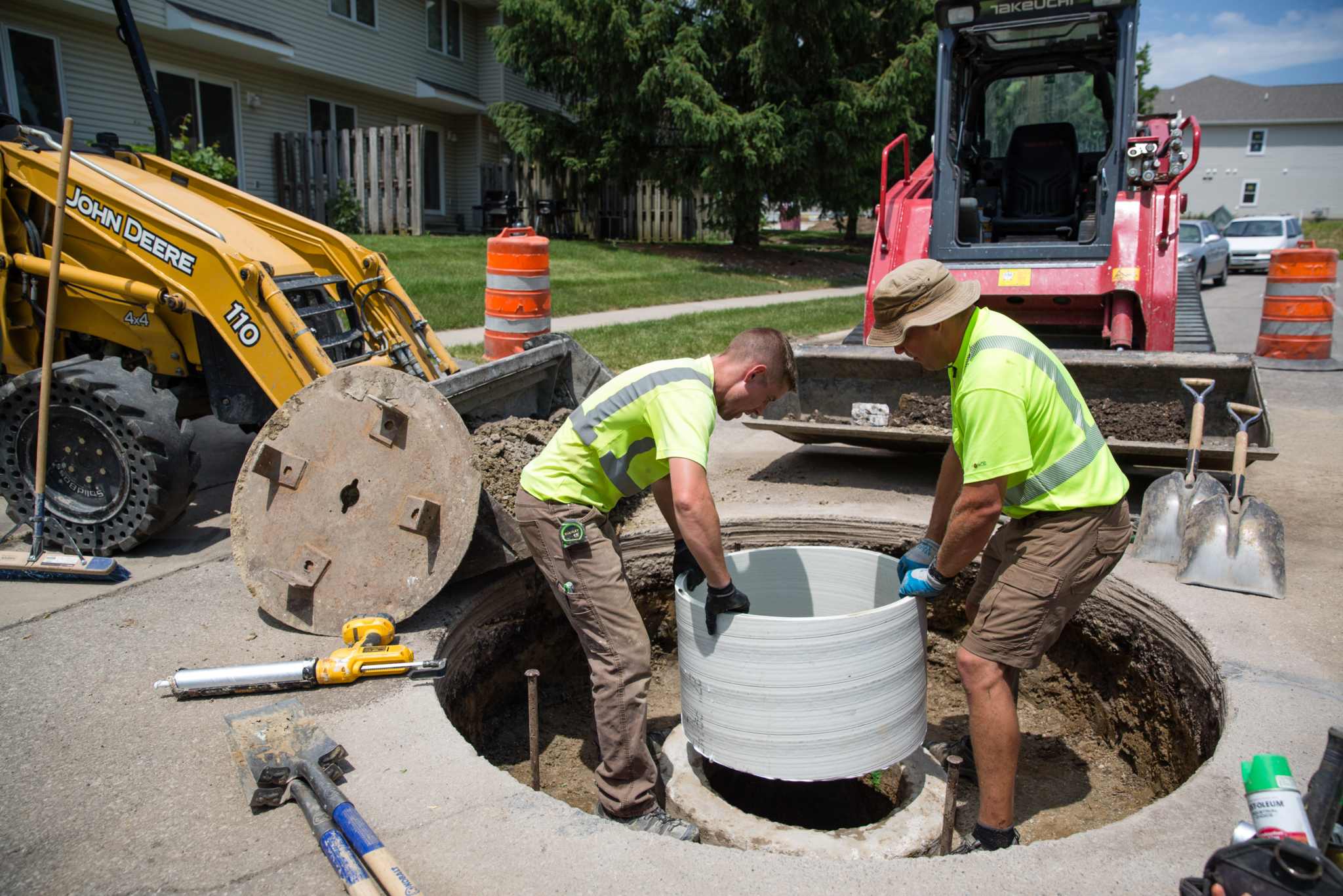 Shawn Kinney and Brad Steenhoek of Save Our Sewers, featured in the March issue, work on replacing a manhole in Ames, Iowa.