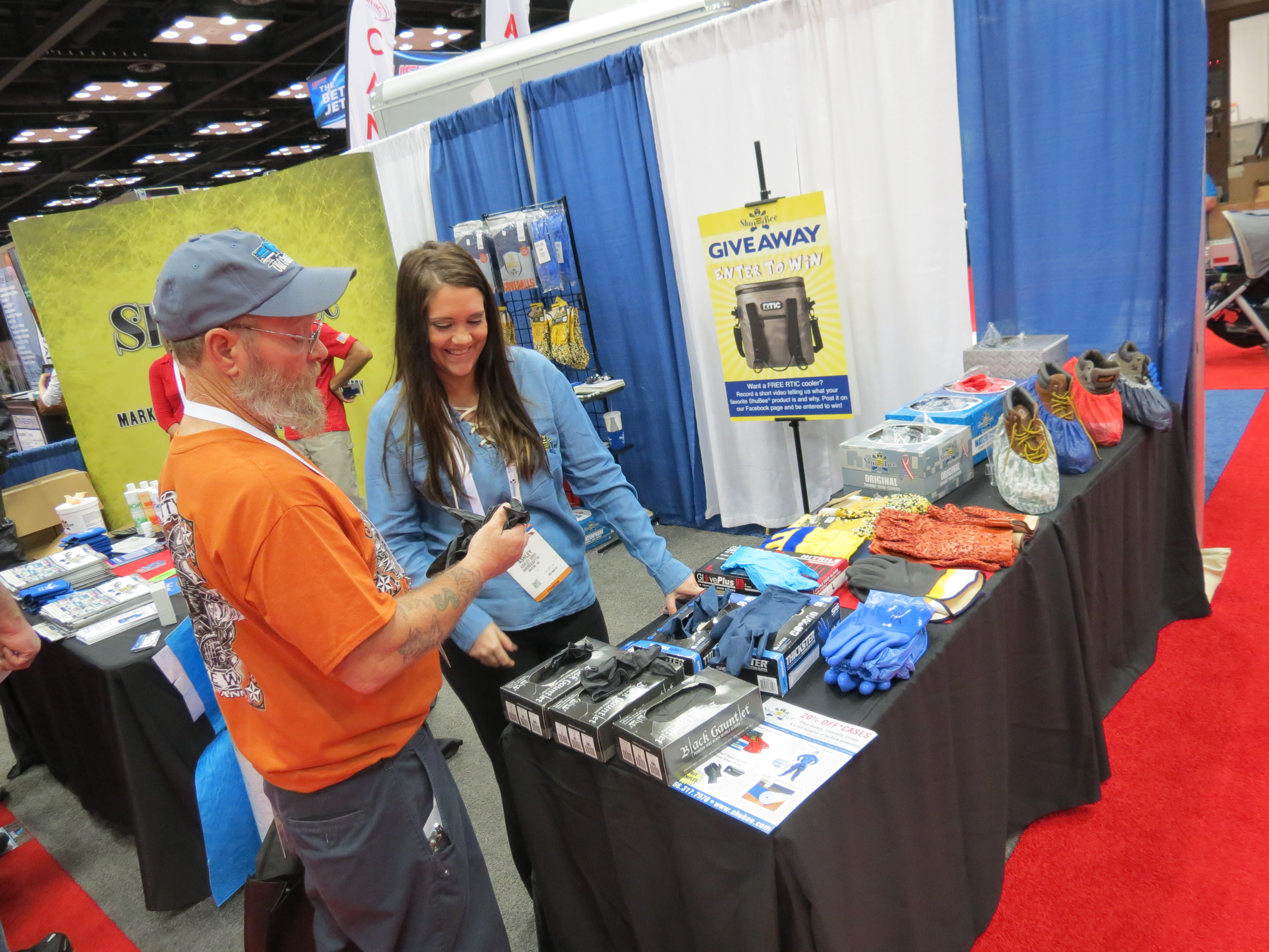 Ashley Eddy (right) of Shubee shows an attendee the company's line of products at the WWETT Show earlier this year.
